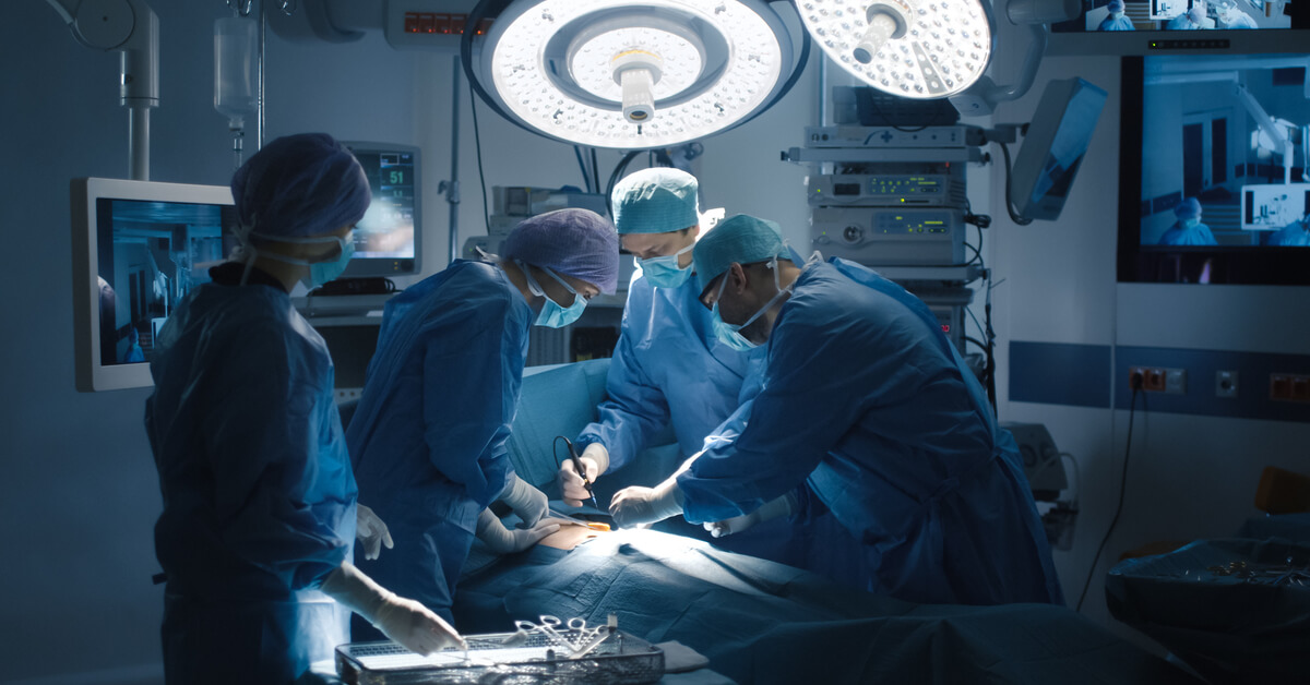 surgeons operating on a patient in an operating room
