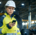 female construction worker using mobile device