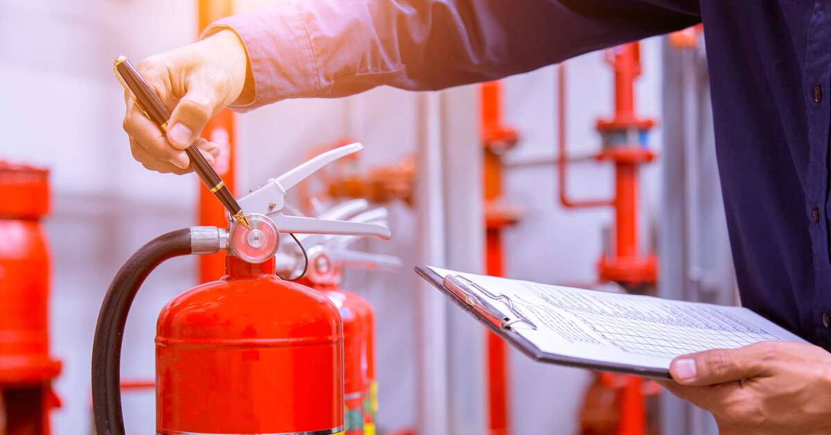 checking fire extinguishers on construction site